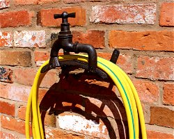 Rustic Cast Iron Wall Mounted Hosepipe Holder