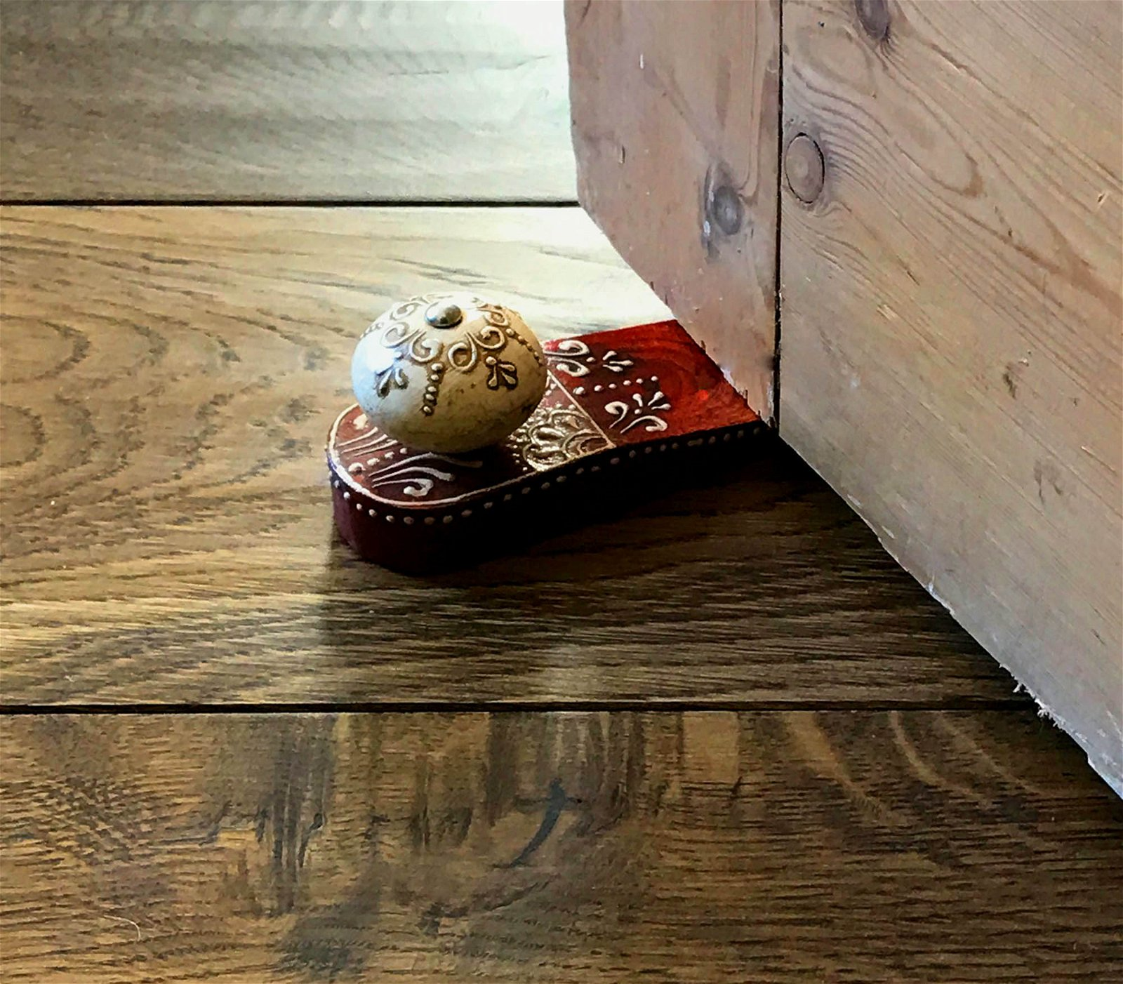 Red Doorstop With Wooden Knob